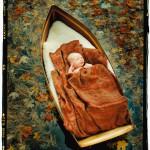 BABY IN BOAT